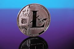 Litecoin crypto currency coin on reflective colorful background Stock Photography