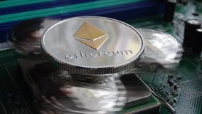 Ethereum Crypto Currency, rotating mirror surface, computer motherboard stock footage