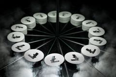 Litecoin Crypto Currency Symbol on Mirror and Covered in Smoke stock image