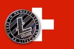 litecoin da moeda da ilustração 3D na bandeira de Suíça Fotografia de Stock Royalty Free