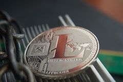 Litecoin de prata no refrigerador do computador do thealuminum imagem de stock royalty free