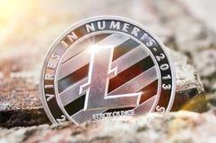 Litecoin is een moderne manier van uitwisseling en deze crypto munt stock afbeeldingen