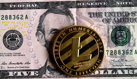 Litecoin on five  dollar banknote. Cryptocurrency Trading concept Royalty Free Stock Photography