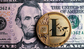 Litecoin on five  dollar banknote. Cryptocurrency Trading concept Stock Image