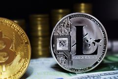 Litecoin LTC is surrounded by a money background. Concept of cryptocurrency royalty free stock images