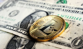 Litecoin one dollar. Litecoin on one dollar banknote Stock Images