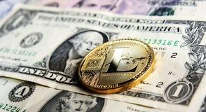 Litecoin one dollar. Litecoin on one dollar banknote Royalty Free Stock Photos