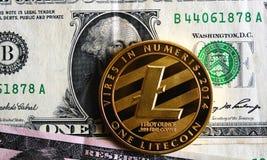 Litecoin one dollar. Litecoin on one dollar banknote Stock Photography