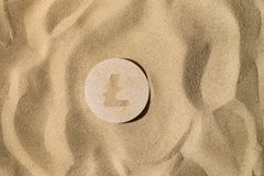 Litecoin Sign On the Sand royalty free stock image