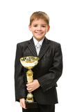 Liten affärsman med den guld- koppen royaltyfria bilder