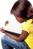 Liten afrikansk skolaflicka Arkivbild