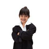 Liten asiatisk flicka i affärsdräkt Royaltyfri Fotografi