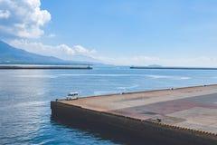 Liten bil på Kagoshima port royaltyfri foto