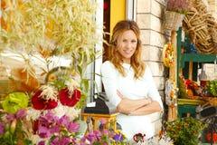 Liten blomsterhandelägare Arkivfoton