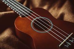 Liten brun ukulele royaltyfri fotografi