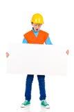 Liten byggnadsarbetare med plakatet Fotografering för Bildbyråer