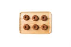 Liten chokladmunk på träplattan Arkivbild