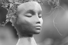 Liten docka med stängda ögon Royaltyfri Bild