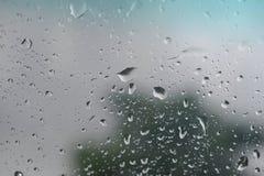 liten droppeexponeringsglasvatten Arkivbild