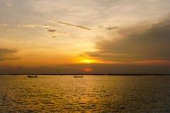 Liten fiskebåt två med solnedgångljus royaltyfri foto
