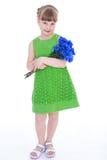 Liten flicka av blommor. arkivfoton