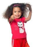 Liten flicka för afrikansk amerikan som pekar till kameran Royaltyfria Bilder