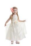 Liten flicka i beige klänning Arkivfoto