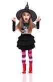 Liten flicka i den halloween dräkten Arkivbilder