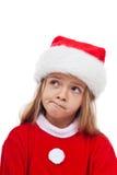 Liten flicka i den Santa Claus dräkten Royaltyfri Foto