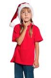 Liten flicka i den Santa hatten Arkivbilder