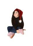 Liten flicka i en hatt av Santa Claus Arkivfoton