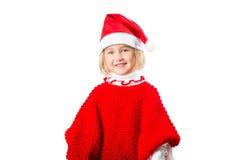 Liten flicka i en hatt Santa Claus på vit bakgrund Fotografering för Bildbyråer