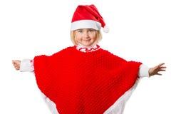 Liten flicka i en hatt Santa Claus på vit bakgrund Royaltyfri Bild