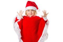 Liten flicka i en hatt Santa Claus på vit bakgrund Arkivbilder