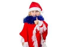 Liten flicka i en hatt Santa Claus på vit bakgrund Arkivbild