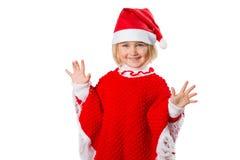 Liten flicka i en hatt Santa Claus på vit bakgrund Royaltyfri Fotografi