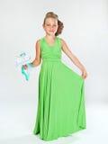 Liten flicka i en smart klänning Arkivfoton