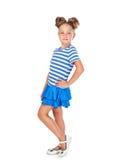 Liten flicka i en smart klänning Royaltyfria Bilder