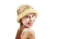 Liten flicka i en vide- hatt Arkivbild