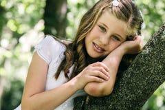 Liten flicka i henne första nattvardsgångdag Royaltyfria Bilder