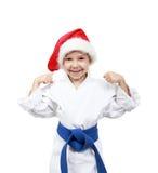 Liten flicka i kimonot och beanien Santa Claus Arkivbild