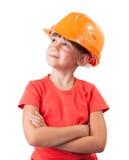 Liten flicka i konstruktionshjälmen Royaltyfri Foto