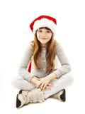Liten flicka i röd jultomtenhatt arkivbilder