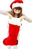 Liten flicka i röd jultomtenhatt royaltyfria foton