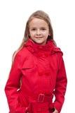Liten flicka i rött täcker Arkivfoto