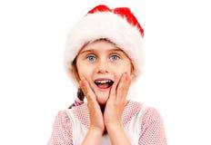 Liten flicka i Santa Hat Arkivfoto
