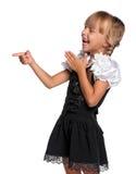 Liten flicka i skolalikformig Arkivfoto
