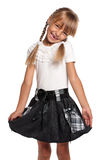 Liten flicka i skolalikformig Fotografering för Bildbyråer