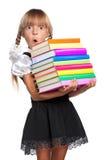 Liten flicka med böcker Royaltyfri Bild