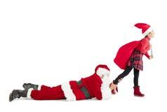 Liten flicka med begrepp Santa Claus för glad jul Arkivbild